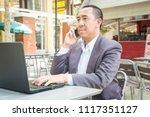 asian businessman use wireless...   Shutterstock . vector #1117351127
