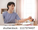 young woman working at desk....   Shutterstock . vector #1117374437