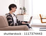 young woman working with laptop ...   Shutterstock . vector #1117374443