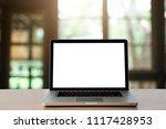 workspace wood desk with laptop ...   Shutterstock . vector #1117428953