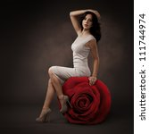 Elegant Beautiful Woman And Big Red Rose On Dark Background - stock photo