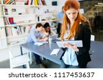businesswoman in modern office | Shutterstock . vector #1117453637