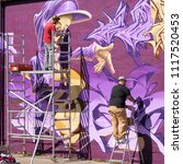 Small photo of MAGDEBURG, GERMANY – MAY 20, 2018: Graffiti artist on the grounds of the Aerosol Arena in Magdeburg. The Aerosol Arena is a former company site that was provided to graffiti sprayers