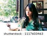 beautiful asian woman sitting... | Shutterstock . vector #1117603463