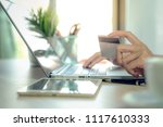 business woman use credit card...   Shutterstock . vector #1117610333