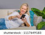 beautiful and happy blond woman ... | Shutterstock . vector #1117649183