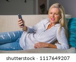 beautiful and happy blond woman ... | Shutterstock . vector #1117649207