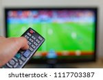 man watching match on tv and... | Shutterstock . vector #1117703387