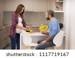 young pregnant couple cooking... | Shutterstock . vector #1117719167