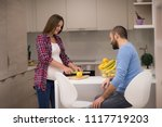 young pregnant couple cooking... | Shutterstock . vector #1117719203