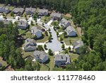 Modern comfortable middle class neighborhood aerial in the southeastern USA. - stock photo