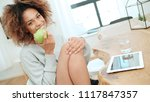 young woman with green apple.... | Shutterstock . vector #1117847357