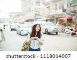 woman traveler photographer... | Shutterstock . vector #1118014007