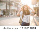 young beautiful female traveler ... | Shutterstock . vector #1118014013