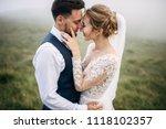 bride and groom are standing... | Shutterstock . vector #1118102357