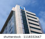 building with large h sign for... | Shutterstock . vector #1118332667