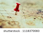 red pushpin in an old map. | Shutterstock . vector #1118370083