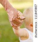 hands of a grandfather and child - stock photo