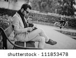 Business man write his tasks in a notebook, black and white photography - stock photo