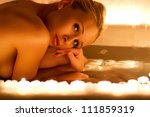 Lovely young woman relaxing in bathroom - stock photo