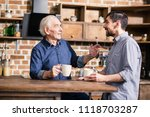 just talk. pleasant elderly man ... | Shutterstock . vector #1118703287