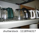 Small photo of Coffee maker pots on a shelf in a resale store