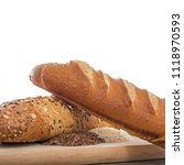 Small photo of Loaf of bread, lint, sunflower and sesame on cutting board on wooden background