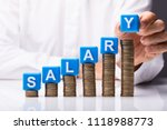 person's hand making salary...   Shutterstock . vector #1118988773