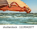 wind on orange stripes sunshade ... | Shutterstock . vector #1119042077