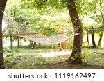 empty hammock outdoors on sunny ... | Shutterstock . vector #1119162497