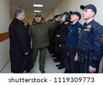 Small photo of At the barrack. Officer showing soldier's outfit to the President of Ukraine Petro Poroshenko. Opening International training centre of National guard of Ukraine. March 23, 2018. Staroe, Ukraine