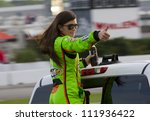 ATLANTA, GA - SEP 02, 2012:  Danica Patrick (10) waves to the crowd before she races at the AdvoCare 500 at the Atlanta Motor Speedway in Hampton, GA. - stock photo