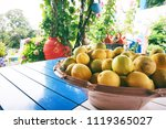 bowl with lemons on a table | Shutterstock . vector #1119365027