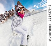 A Young Woman Skiing In The...