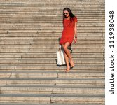 Photos pretty girl walking on the big stairs - stock photo