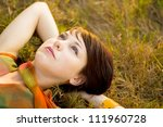 Spring Girl lying on the Field - stock photo