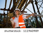 A young female constructor at building of a new motorway in Germany - stock photo