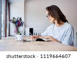 young student writing in... | Shutterstock . vector #1119664607