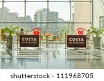MANCHESTER, ENGLAND - MAY 26: A Costa Coffee coffee house seating area on May 26, 2012 in Manchester, England. Costa Coffee is the world's second largest coffee house chain, after Starbucks. - stock photo