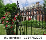 iron fence with hedge of rose... | Shutterstock . vector #1119762203
