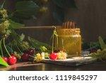 open glass jar of liquid honey... | Shutterstock . vector #1119845297