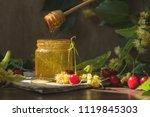 open glass jar of liquid honey... | Shutterstock . vector #1119845303