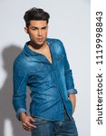 seductive young casual man with ... | Shutterstock . vector #1119998843