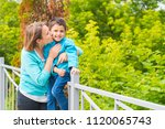 happy mom and son in the park   Shutterstock . vector #1120065743