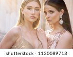 fashion outdoor photo of two... | Shutterstock . vector #1120089713