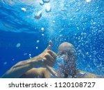the face of a man under water. | Shutterstock . vector #1120108727