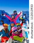 Skiing, winter fun - happy skiers, family  team - stock photo