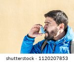 portrait of young man using... | Shutterstock . vector #1120207853