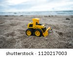 Plastic Toy Tractor In The San...