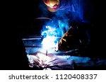 welders working at the factory... | Shutterstock . vector #1120408337